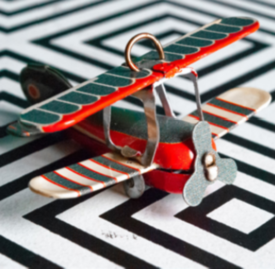 Green and ornage toy plane